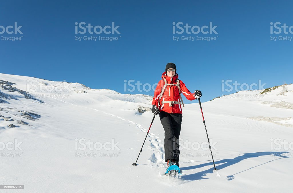 Austrian powder snowshoeing stock photo