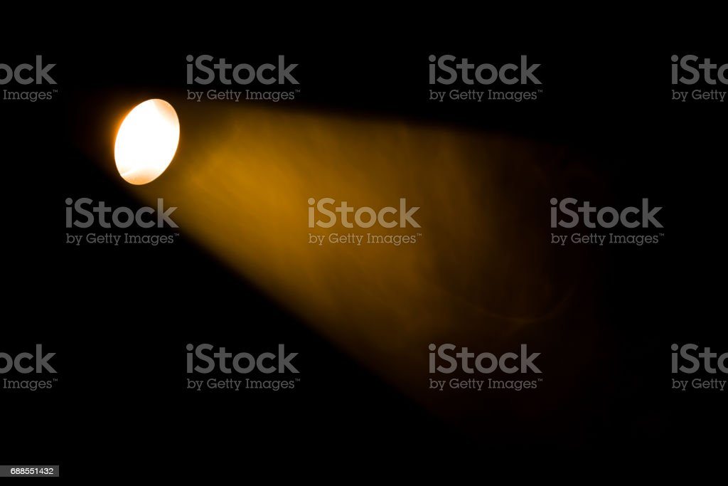 Authentic beam of light from reflector in theatre. stock photo