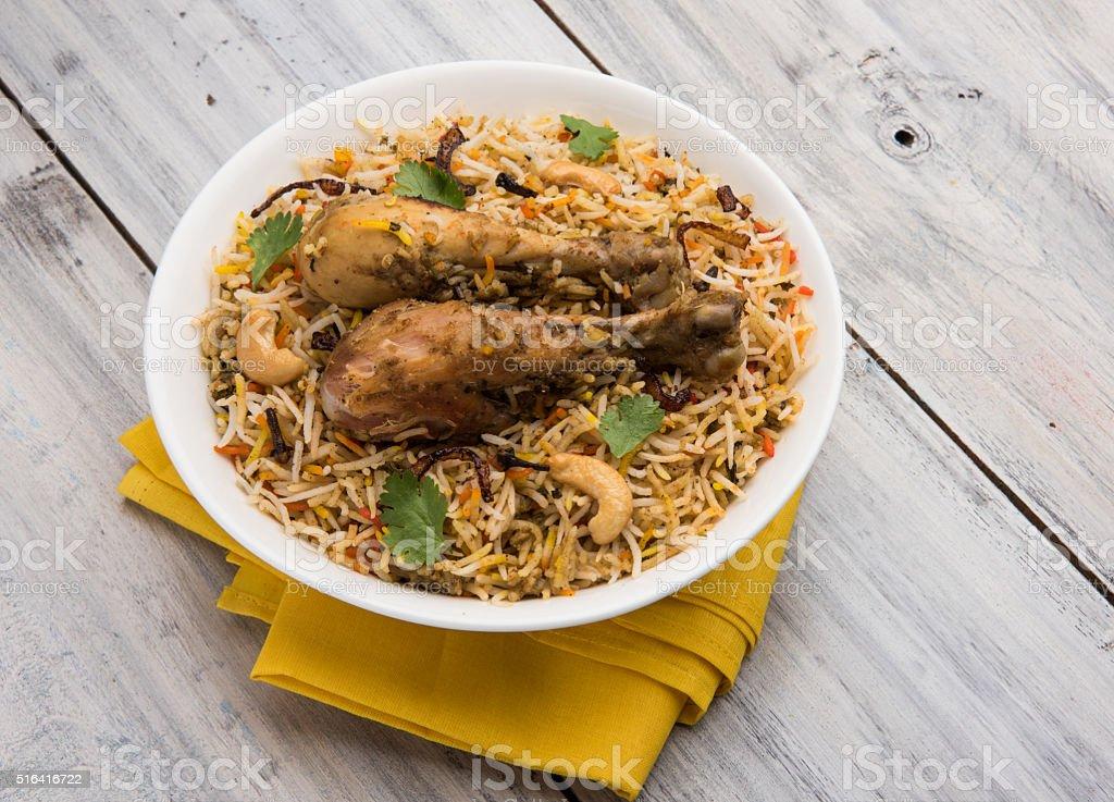 authentic chicken biryani with onion raita stock photo
