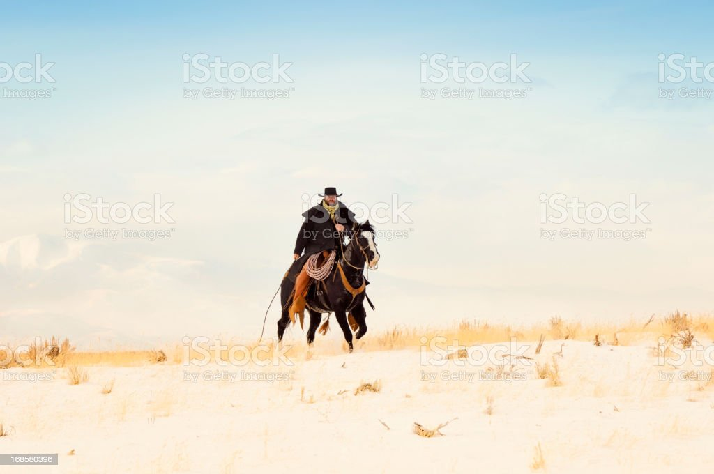 Authentic Cowboy In Winter Scenic royalty-free stock photo