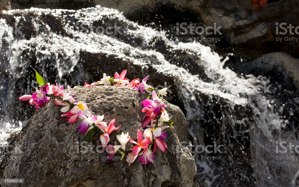 Authentic Hawaiian Lei by a Waterfall royalty-free stock photo