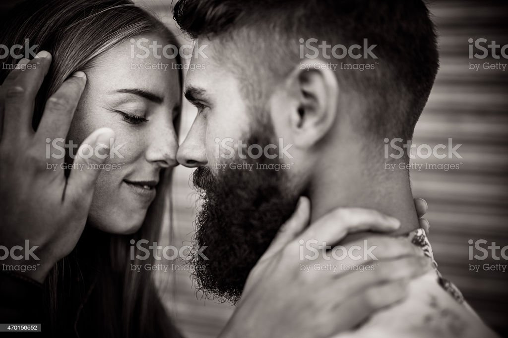 Authentic hipster guy looking lovingly at his girlfriend stock photo