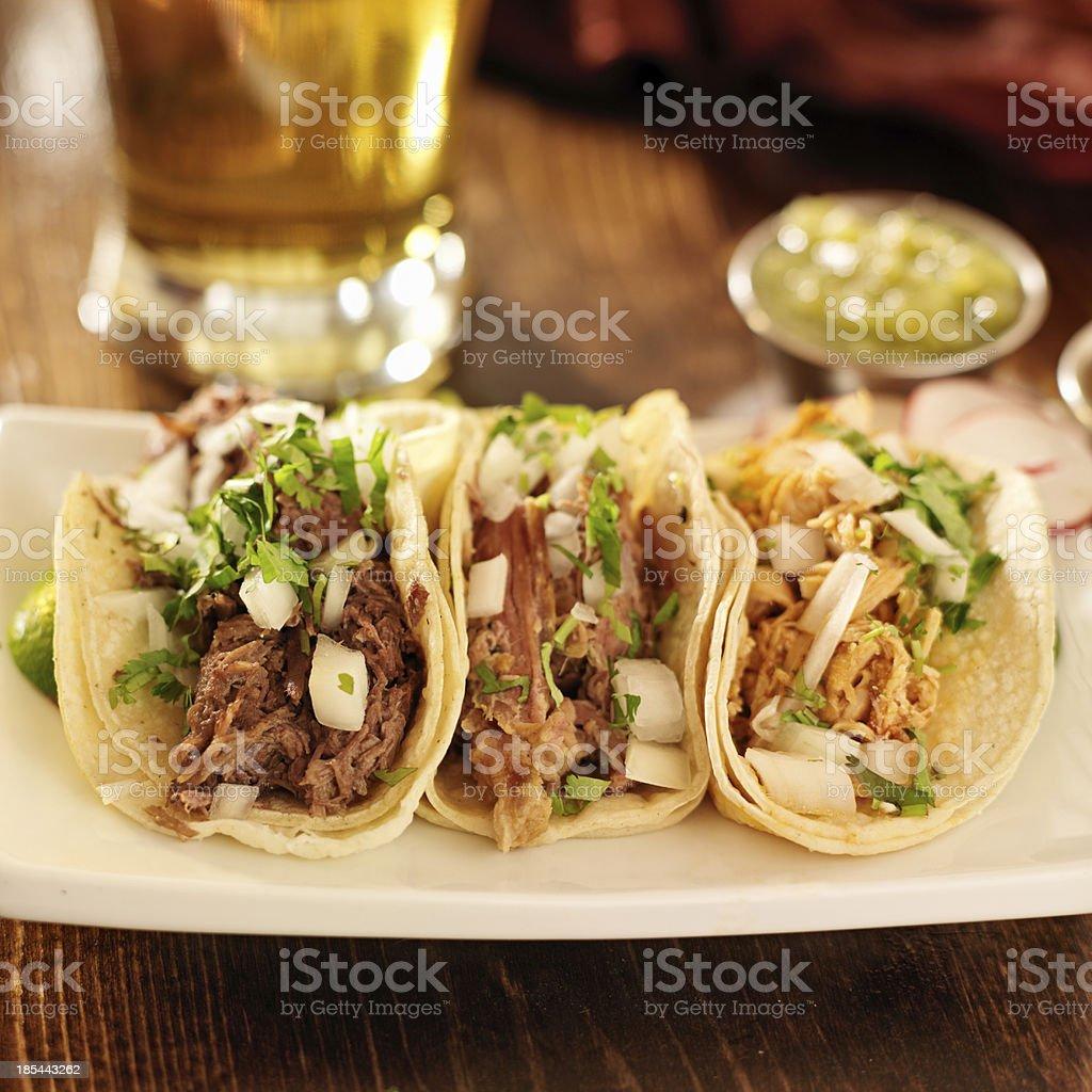 authentic mexican barbacoa, carnitas and chicken tacos stock photo