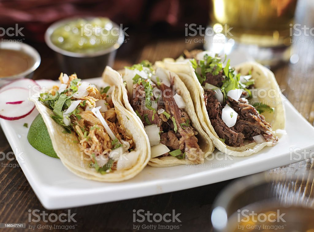 authentic mexican barbacoa, carnitas and chicken tacos stock photo