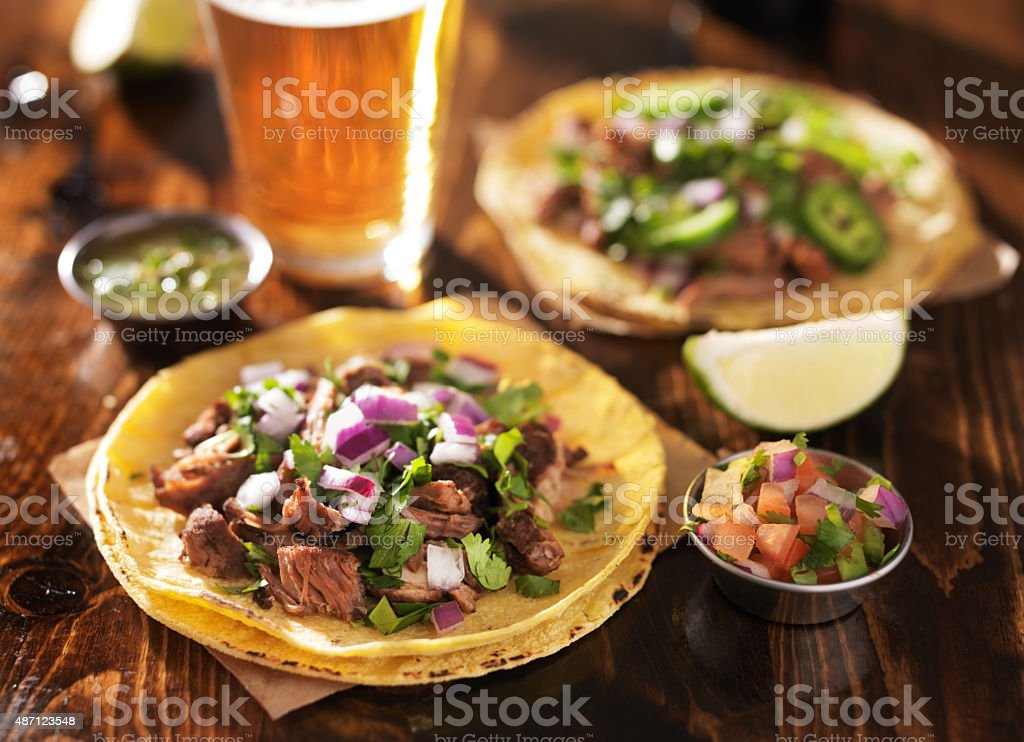 authentic mexican tacos with beer stock photo