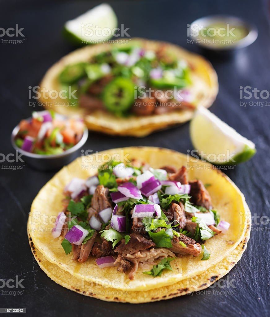 authentic mexican tacos with carnitas and barbacoa stock photo