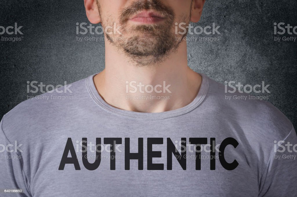 Authentic tittle on gray t-shirt front view stock photo