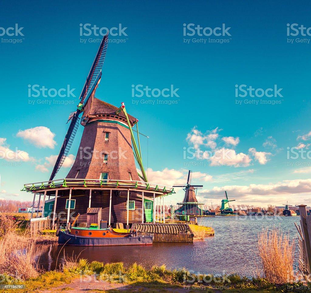 Authentic Zaandam mills on the water channel in Zaanstad village stock photo