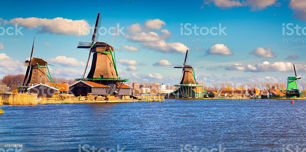 Authentic Zaandam mills on the water channel in Zaanstad willage stock photo