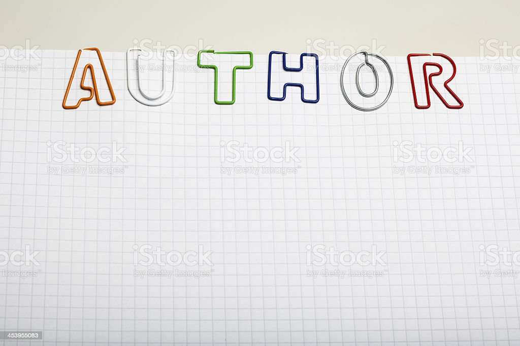 Author spelled with Paper clip letters on notepad royalty-free stock photo