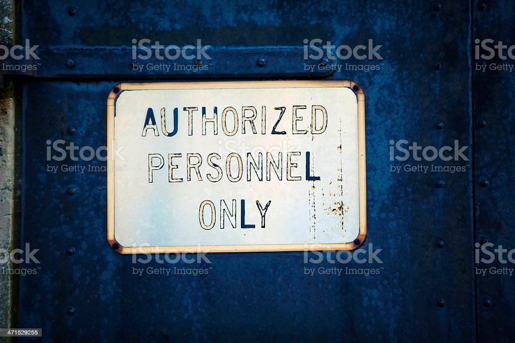 Authorized Personnel Sign on Old Metal Door - effect royalty-free stock photo