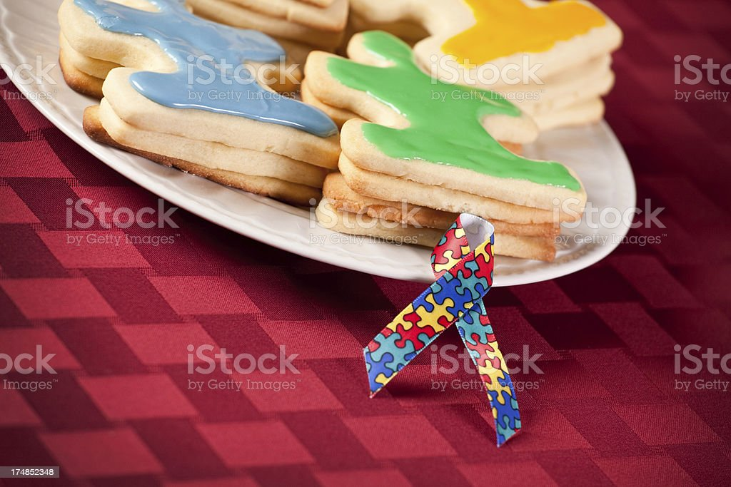 Autism Awareness Puzzle Piece Cookies With Ribbon stock photo