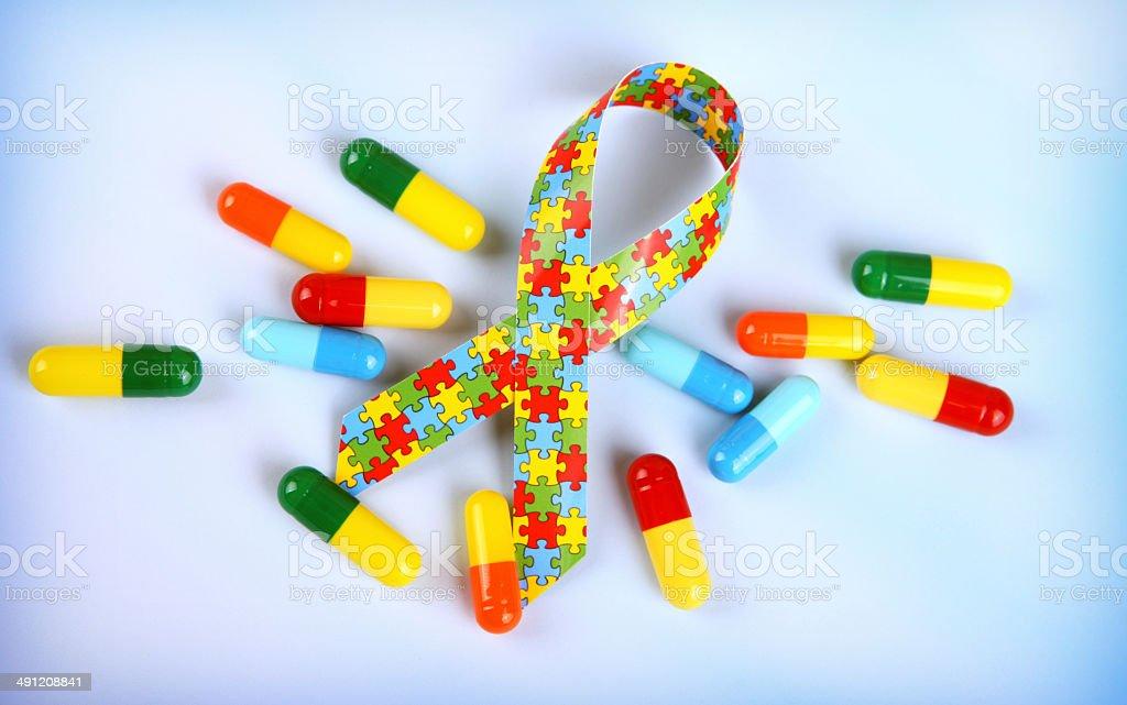 Autism Awareness Ribbon with Capsules stock photo