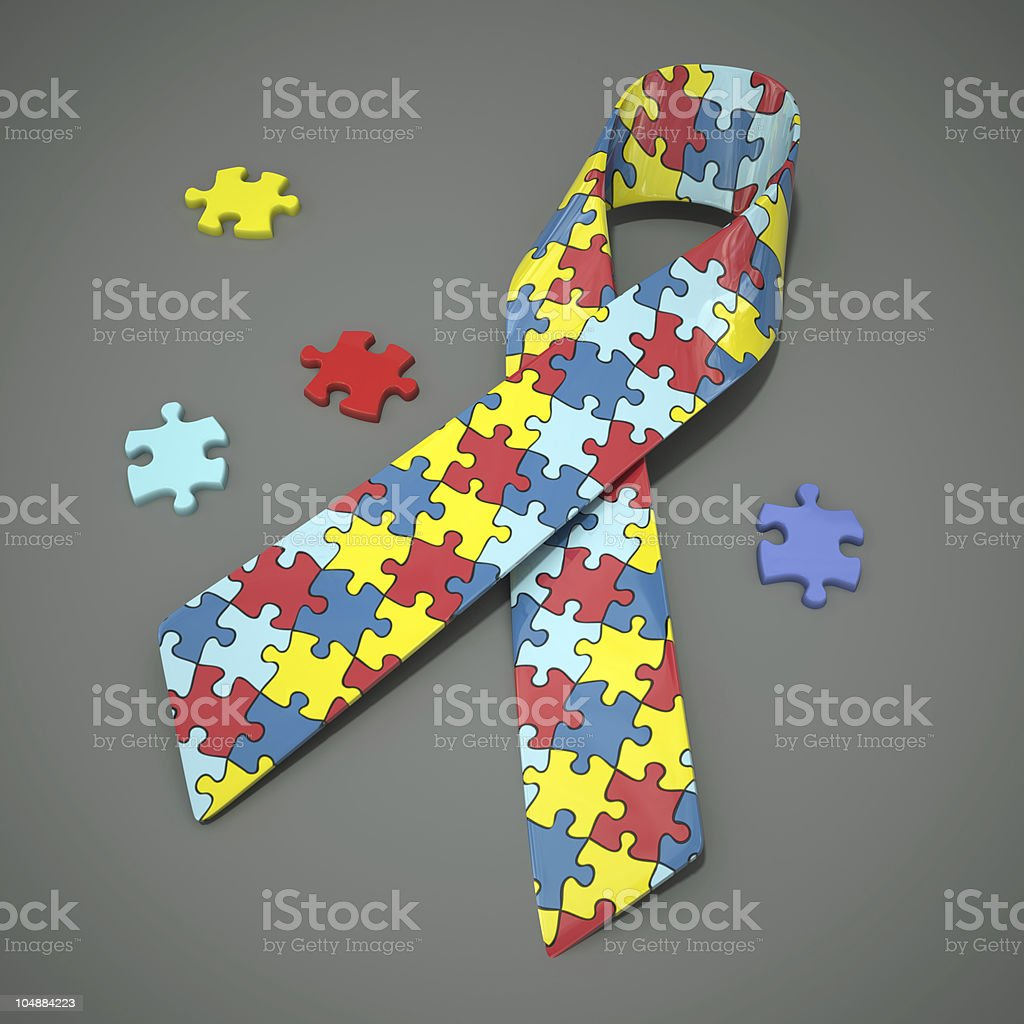 Autism awareness ribbon with colorful puzzles stock photo