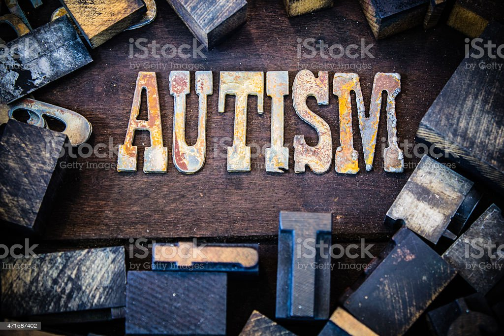 Autism Concept Wood and Rusted Metal Letters stock photo