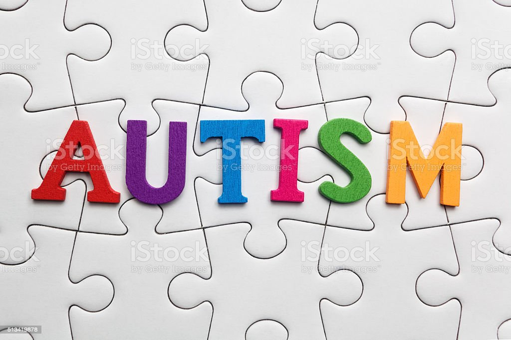 Autism inscription on a white puzzle background stock photo