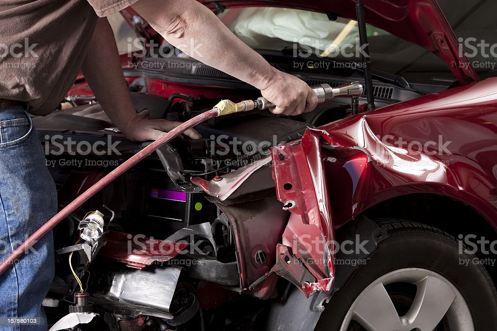 Auto Body Mechanic Disassembling Damaged Vehicle stock photo
