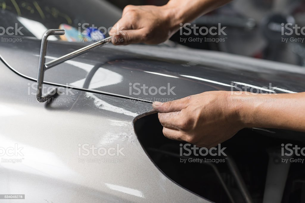Auto body repair series : Fixing car body stock photo