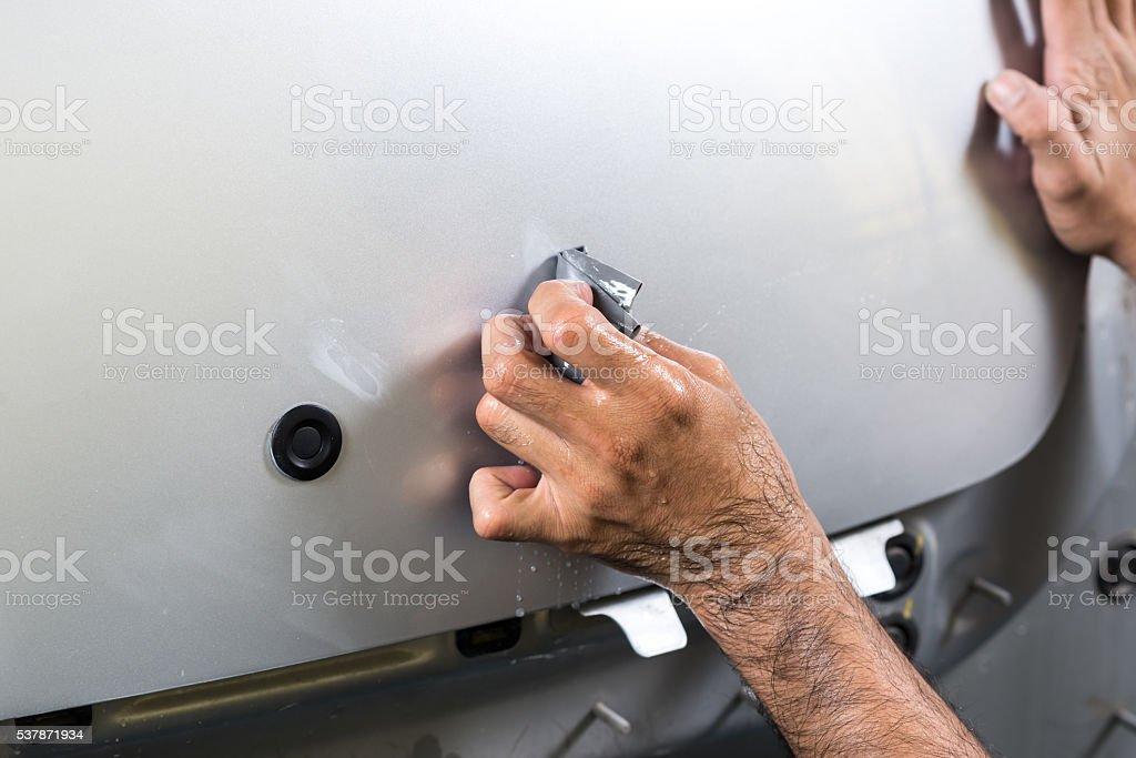 Auto body repair series : Sanding trunk paint stock photo