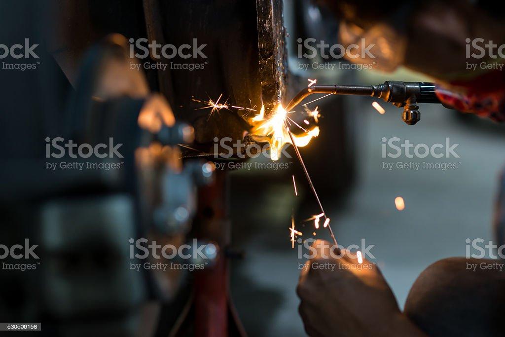 Auto body repair series : Welding in low key lighting stock photo