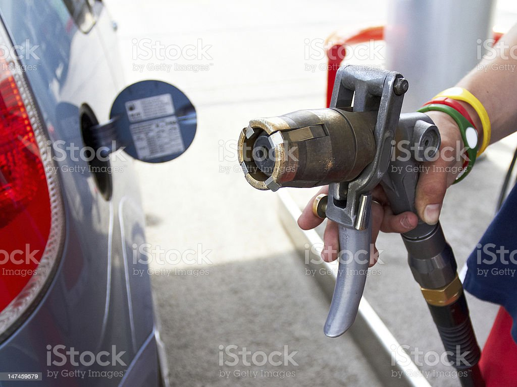 LPG auto gas refueling on petrol station stock photo