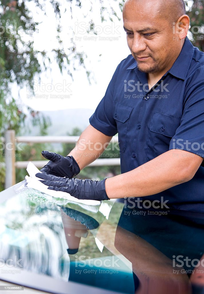 Repairing and replacing the glass on a car.