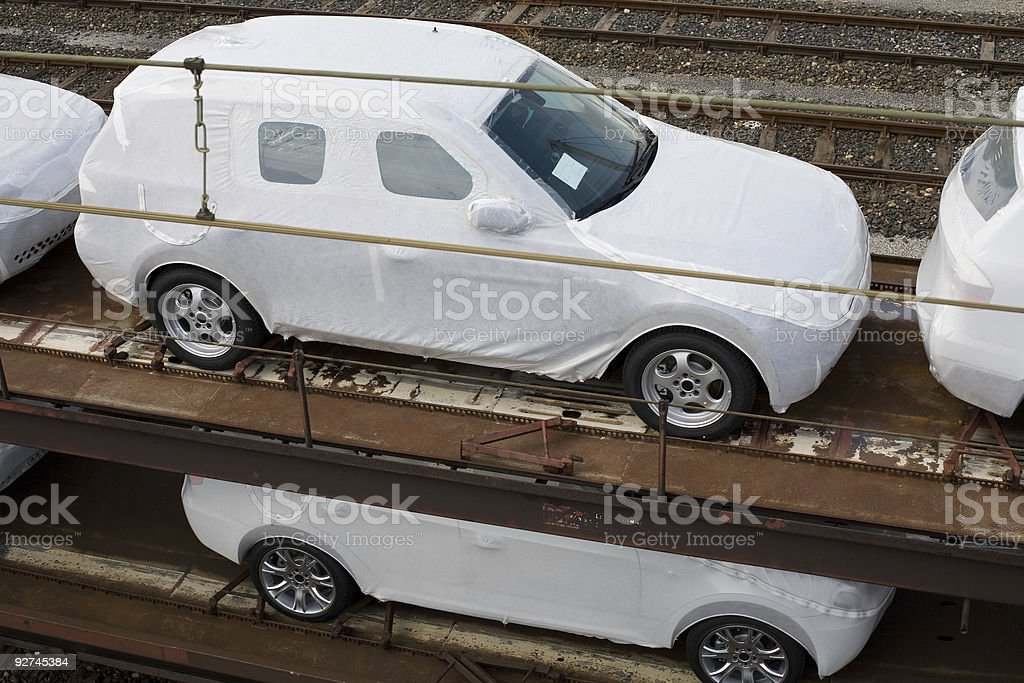 Auto Industry - New Cars On Rail Freight Transporter royalty-free stock photo