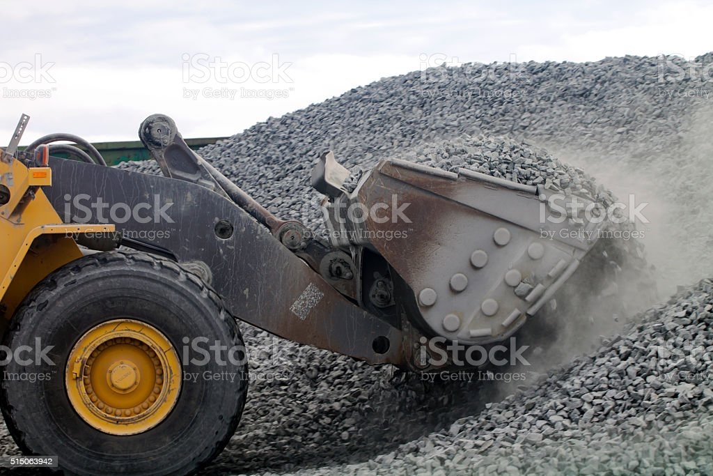 Auto Loader Drawing Gravel Up into Scoop stock photo
