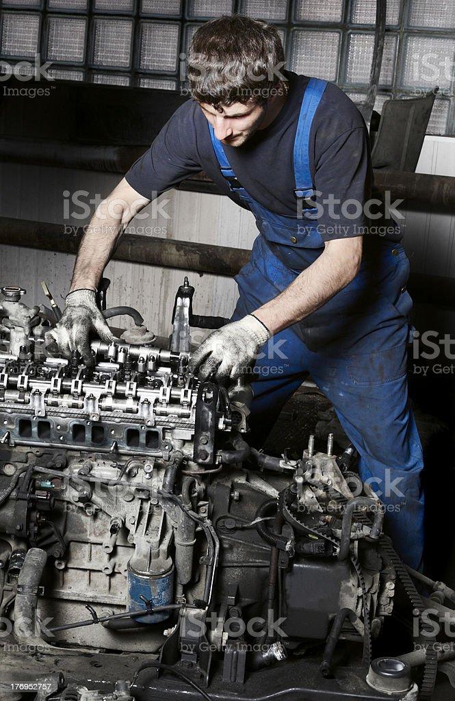 Auto mechanic and engine royalty-free stock photo