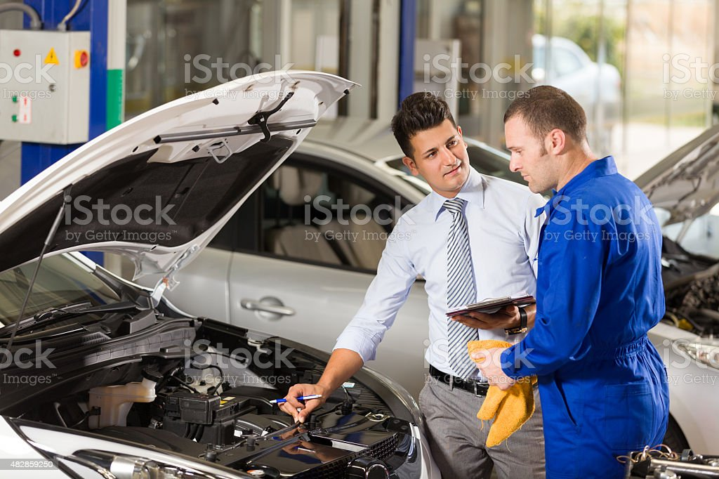 Auto Mechanic and Manager stock photo