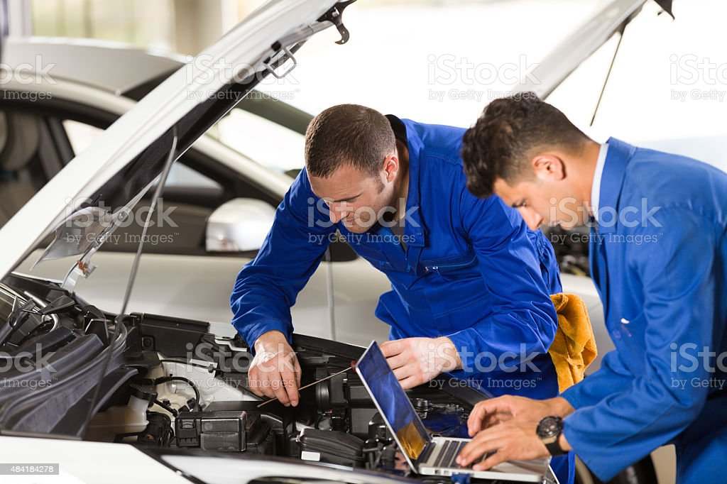 Auto Mechanic and Technician stock photo