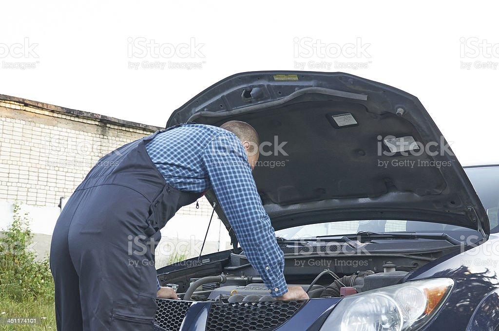 Auto mechanic at car engine repair work royalty-free stock photo