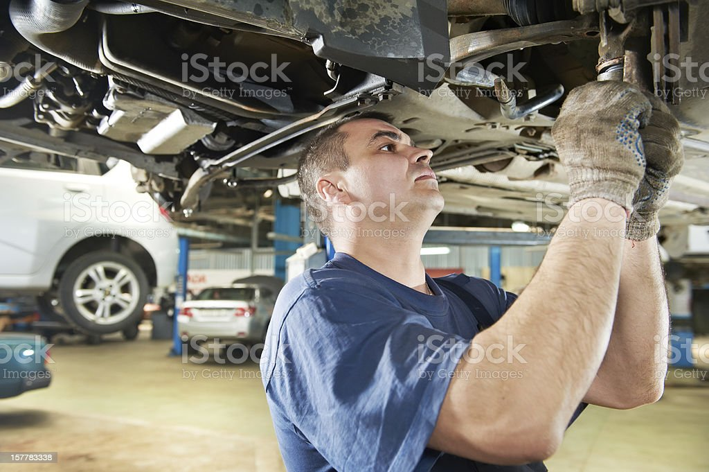 auto mechanic at car suspension repair work stock photo