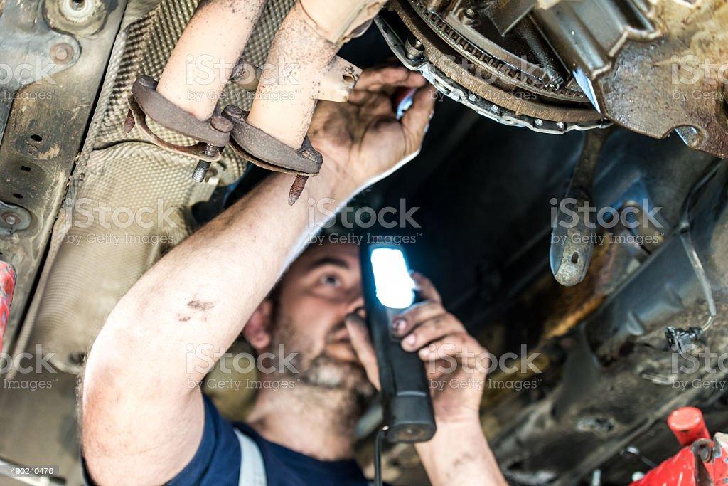 Auto Mechanic at work stock photo