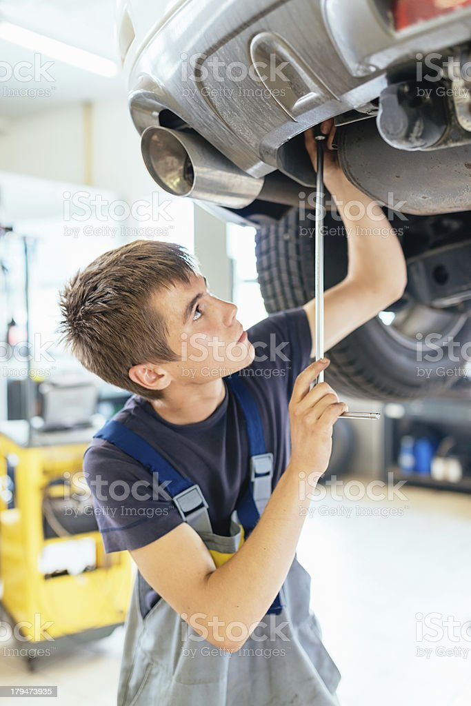 Auto Mechanic at Work Repairing Car royalty-free stock photo