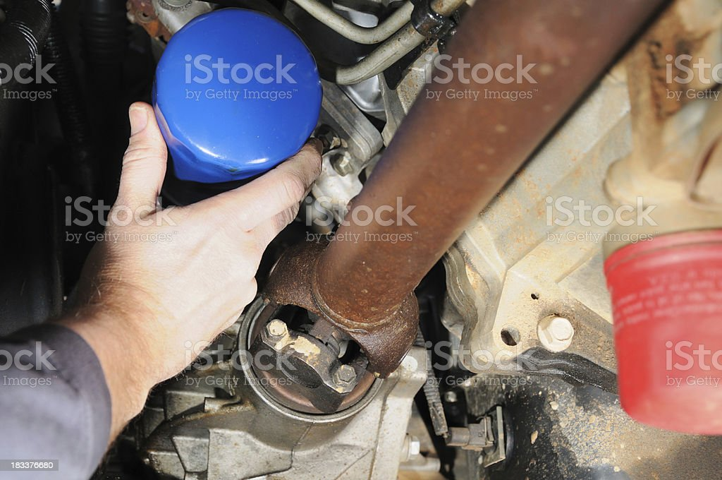 Auto mechanic changing oil filter stock photo
