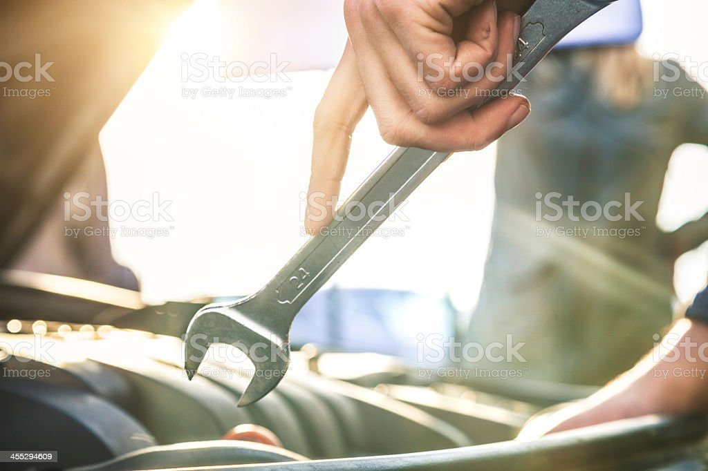 Auto mechanic fixing a car engine stock photo
