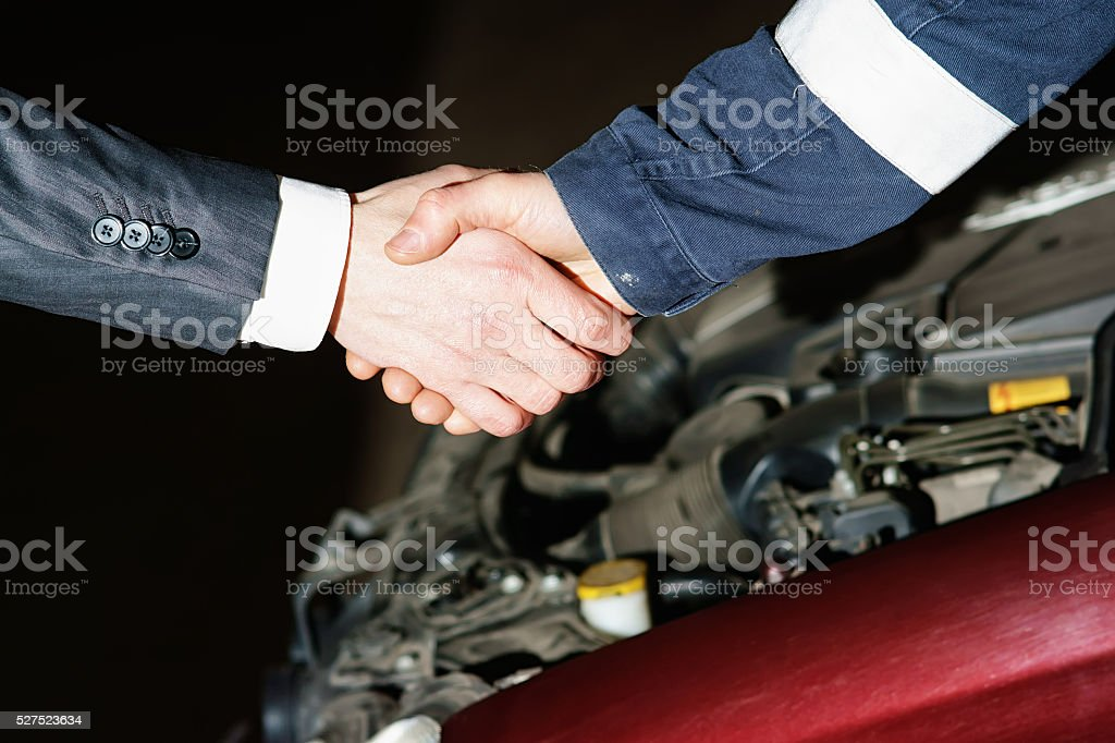 Auto mechanic handshake stock photo
