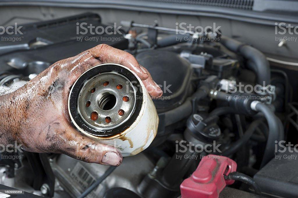 Auto mechanic holding oil filter stock photo