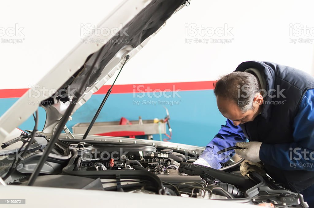 auto mechanic makes inspection and check a diesel engine car stock photo
