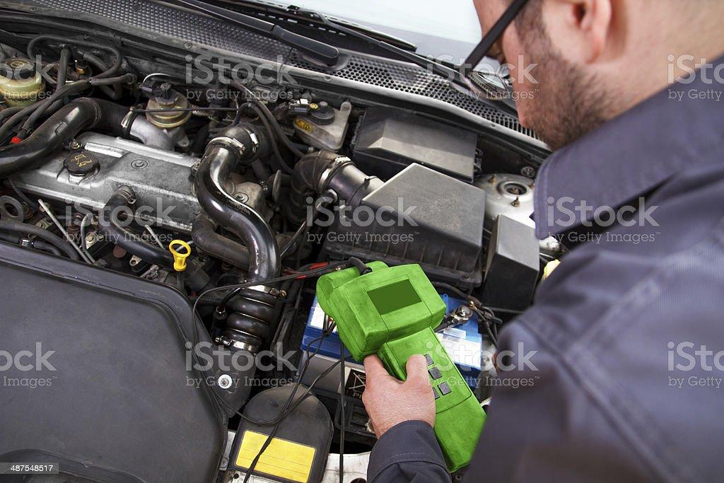 Auto mechanic on work stock photo