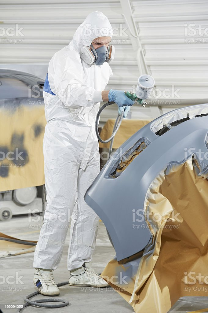 auto mechanic painting car bumper royalty-free stock photo