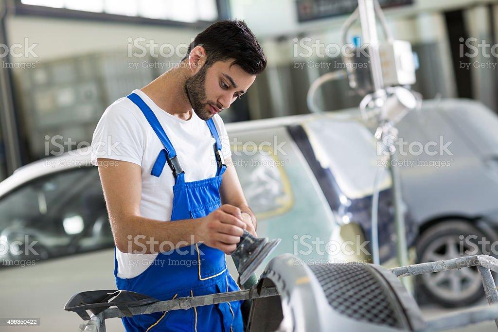 auto mechanic  polished scratches stock photo