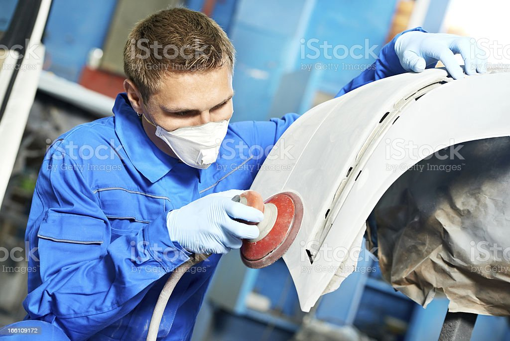 auto mechanic polishing car stock photo