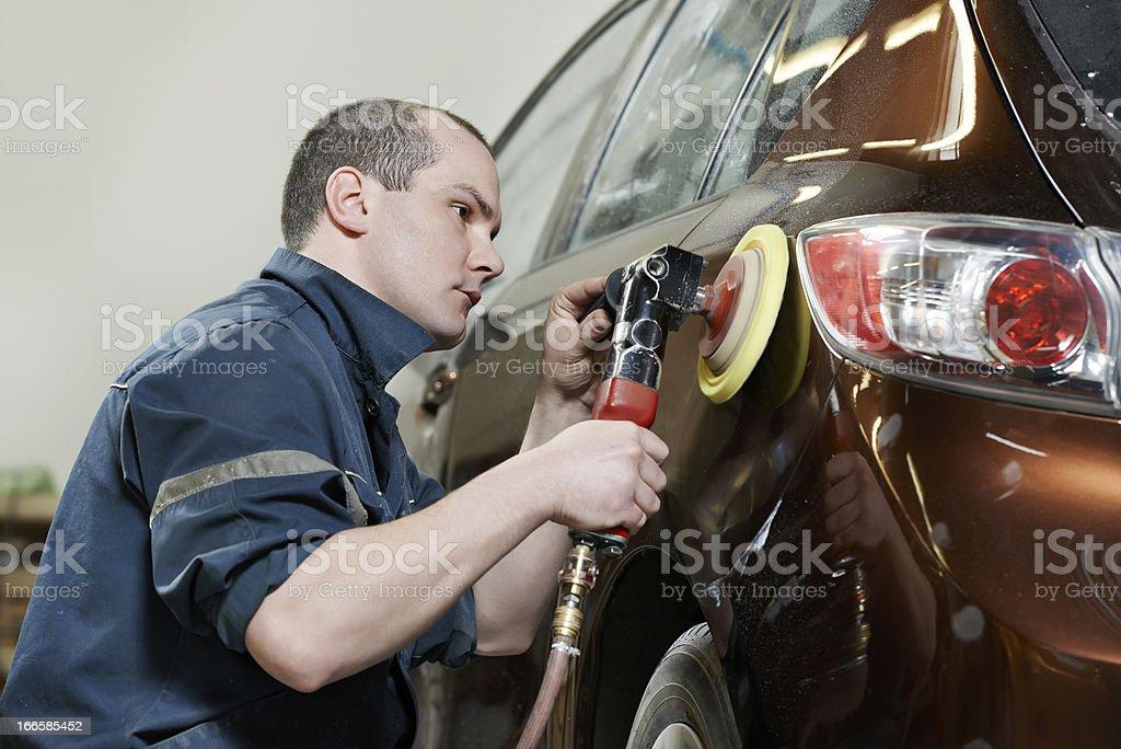 Auto mechanic polishing car with water stock photo