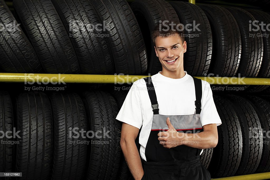Auto mechanic recommend  tire. Thumbs up stock photo