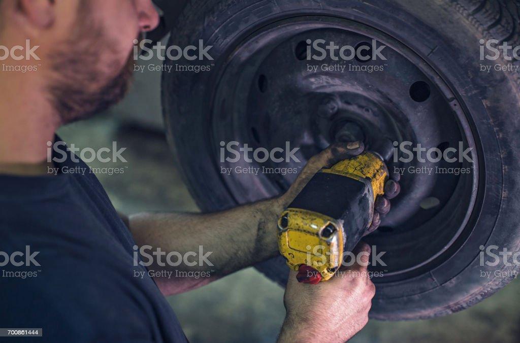 Auto mechanic repairing a car stock photo