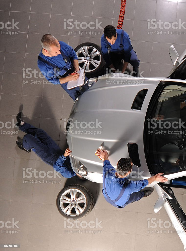 Auto mechanic team repairing the sports car royalty-free stock photo