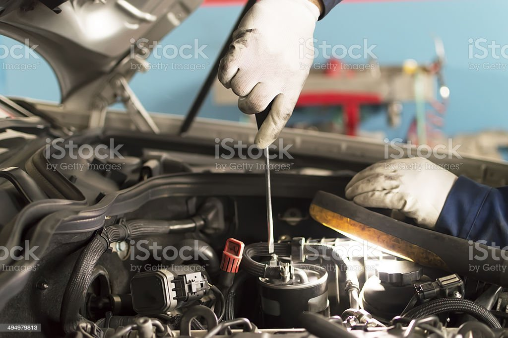 Auto mechanic tighten screw with spanner during automobile car maintenance royalty-free stock photo