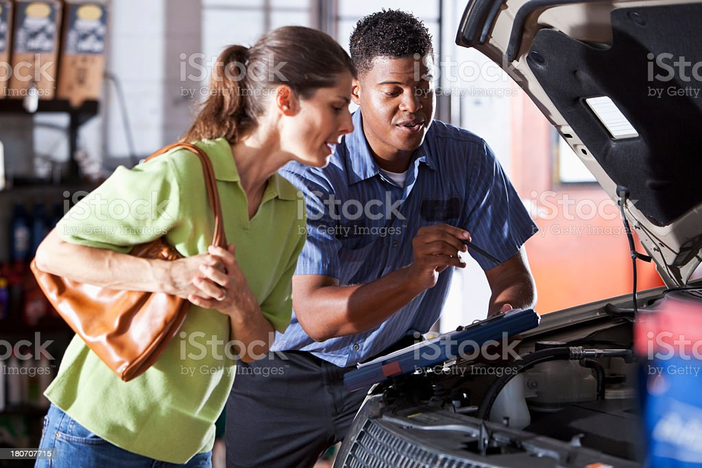 Auto mechanic with customer stock photo